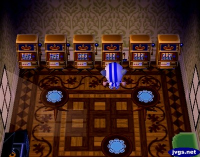 A bunch of slot machines lined up in Anchovy's house.