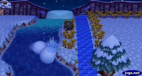 A big splash as I push huge snowballs into the river.
