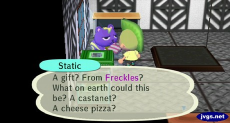 Static: A gift? From Freckles? What on earth could this be? A castanet? A cheese pizza?