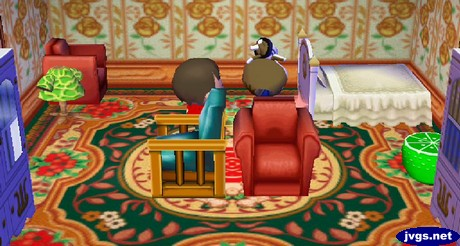 Kitty flips upside down as she takes some medicine in Animal Crossing: City Folk (ACCF) for Nintendo Wii.