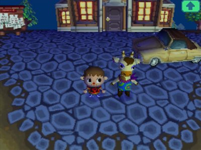 Gracie stands near her car outside of town hall in Animal Crossing: Wild World.