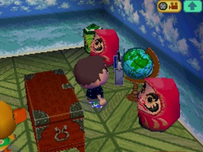 Two dharmas in Joey's house in Animal Crossing: Wild World.