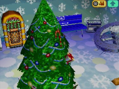 My big festive tree and space station in my Animal Crossing: Wild World house.