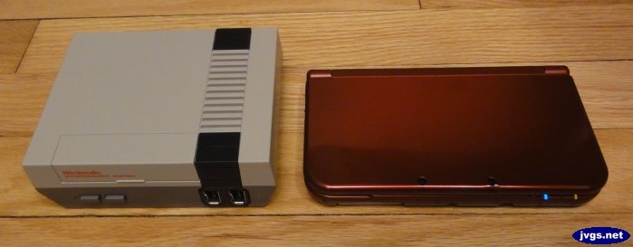 NES Classic Edition system next to a red New 3DS XL.
