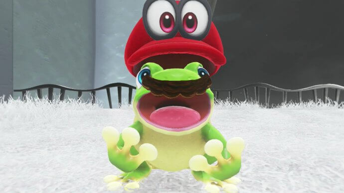 Mario captures a frog in Super Mario Odyssey for Nintendo Switch.