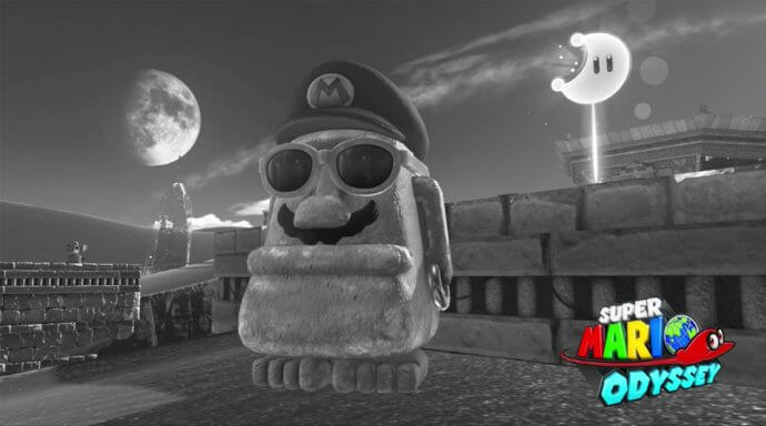 Mario captures a Moai statue and stands near a power moon. Picture taken in Super Mario Odyssey.