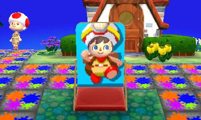 Me sticking my face into a Captain Toad face-cutout standee.