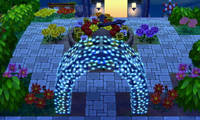 A flower clock and an illuminated arch in the town of Celestia.