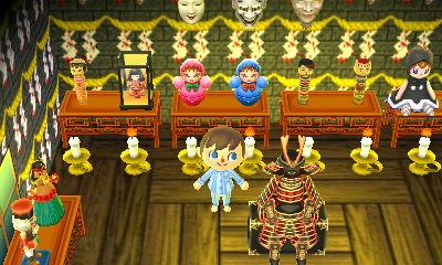 A room full of creepy dolls and masks in Hitokui.