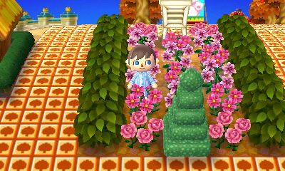 Pink flowers, a square topiary, and an instrument shelter.