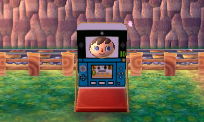 Using a face-cutout standee that has a design of a 3DS system. From the dream town of Anville.