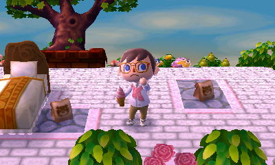 Me holding an ice cream cone in the dream town of Pastelia.