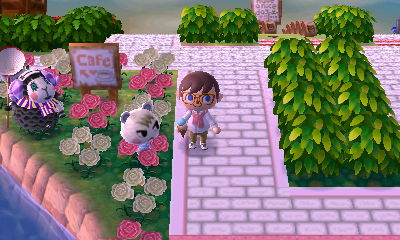 Marshal and Muffy stand by a cafe sign in the dream town of Pastelia.