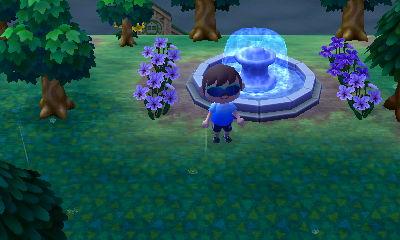 Violets around my town fountain.