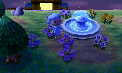 A fountain and flowers in the dream town of Saria.