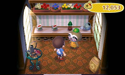 The inside of the garden shop, along with its owner, Leif the sloth.