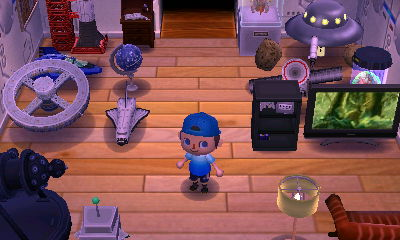A room with space items and a wide-screen TV in the SpotPass home of Lindsey from Autumn.