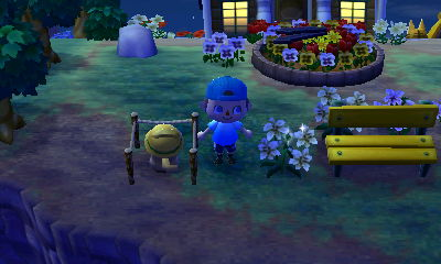 The spot I chose for my street lamp, near my yellow bench and flower clock.