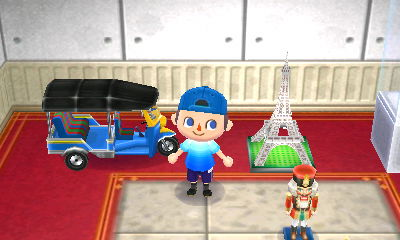 The tuk tuk that Gulliver sent me from Thailand, next to my Eiffel tower.