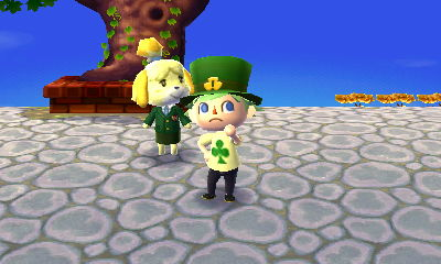 Jeff wearing a shamrock hat next to Isabelle on Shamrock Day (St. Patrick's Day).