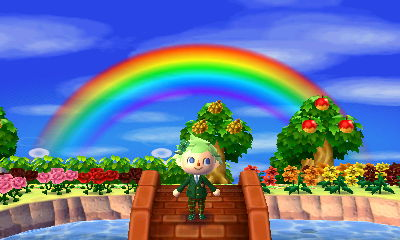 Jeff stands underneath a rainbow in the dream town of Shamrock.