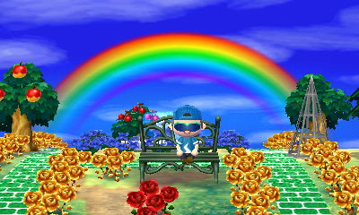 I sit on a metal bench with a rainbow in the sky behind me in Animal Crossing: New Leaf.